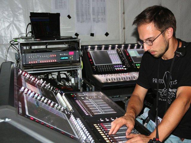 Digico Pope FOH Engineer Tomas Ždanovičius at the DiGiCo SD12 desk pair.jpg