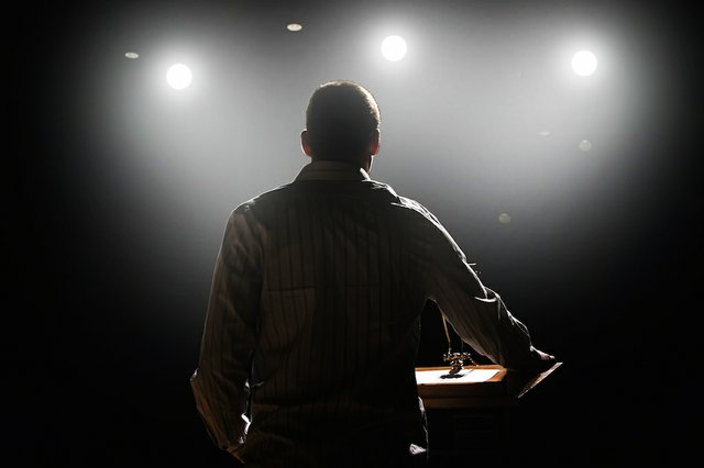 pastor in stage lights.jpg