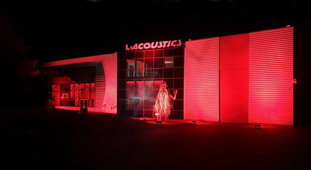 Bob in front of the head office of L-Acoustics and L-Acoustics Group with red light for #We Make Events and #Red Alert Restart, Marcoussis, France
