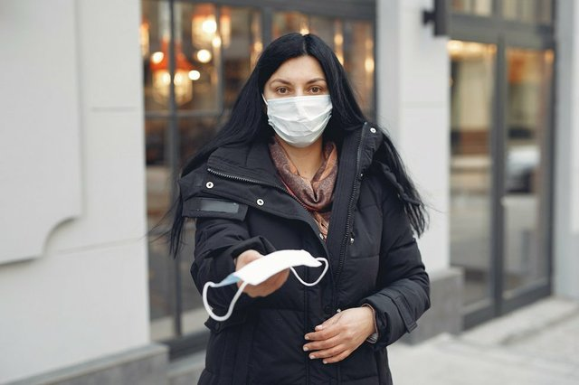 young-woman-wearing-medical-mask-and-black-down-jacket-on-3983407.jpg.jpe