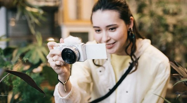 girl with new sony cam.jpg